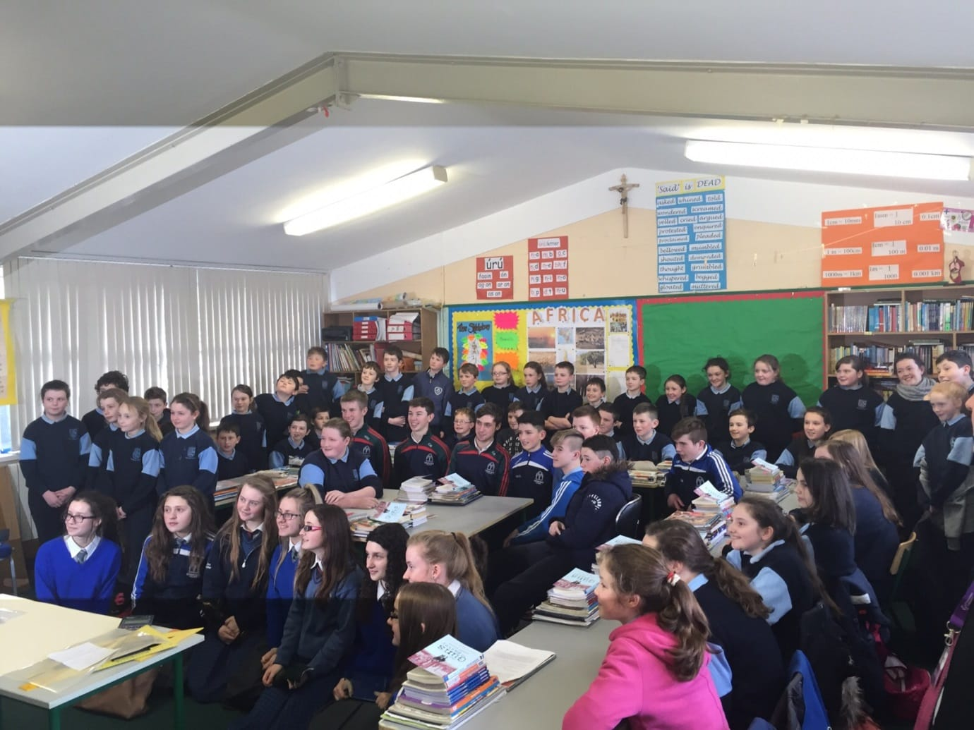 2016 Jan: Students from Demond College and Castlemahon Primary school watch intently to a display by Desmond College Young Scientists students.