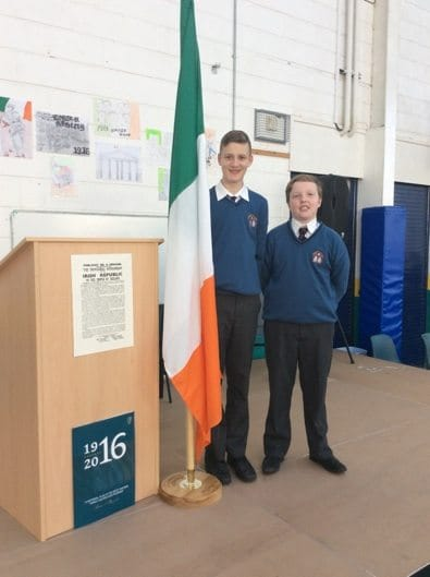 2016 March: Declan Kennedy and Cromac Browne picture after raising the flag at the 1916 commemoration ceremony in Desmond College