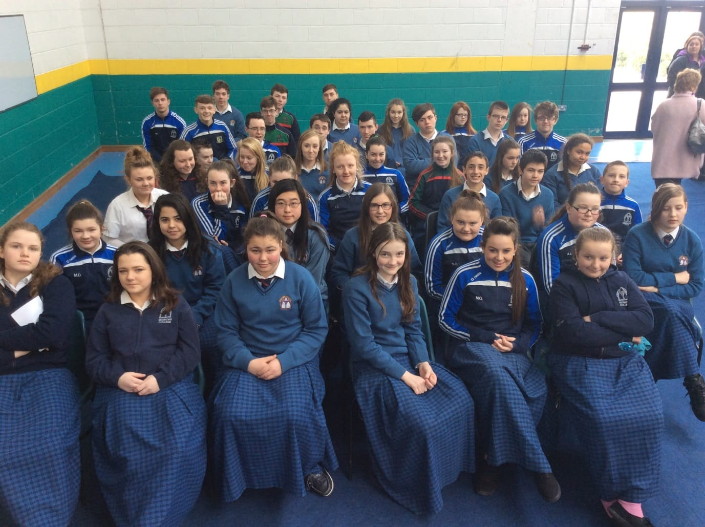 March 2016: Pupils gathering to watch the raising of the flag at the 1916 commemoration ceremony in Desmond College