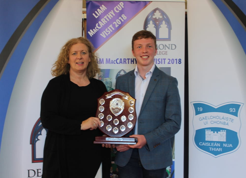 Cormac Browne receiving the Transition Year Student of the Year Award from Ms Vourneen Gavin