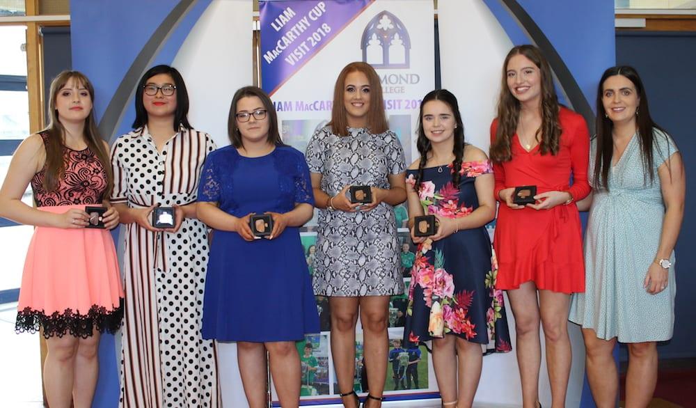 Marcelina Krzywdainska, Joanne Lai, Chlo Aherne, Victoria Brouder, Ciara Brouder, Melissa Flaherty Receiving their Gaisce Award from Ms Culhane