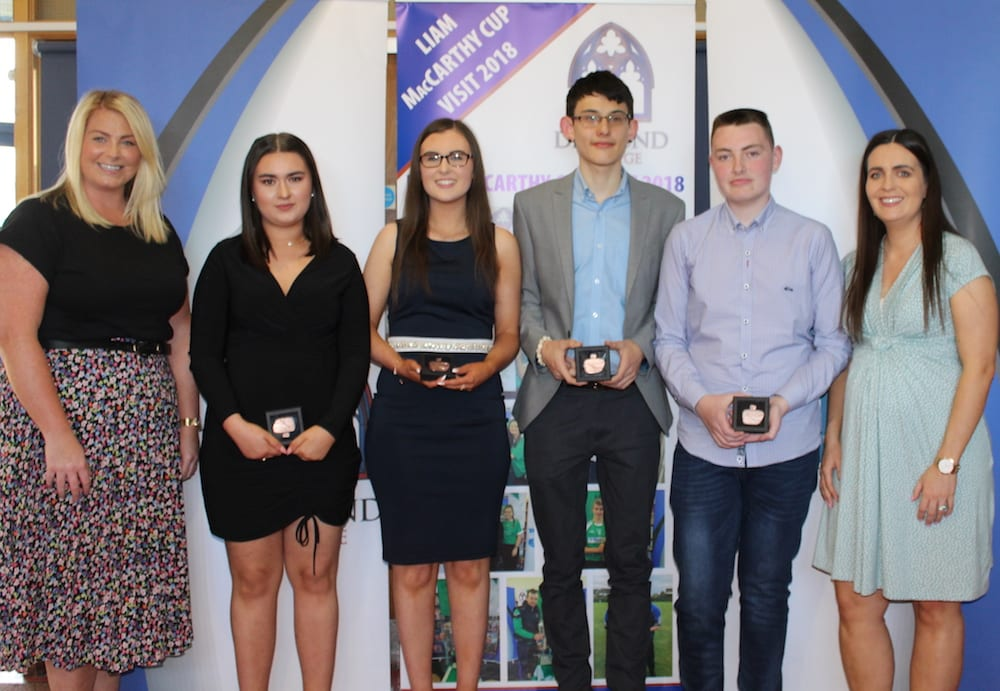 Megan Romo, Mary Sexton, Ronan Mullane and Willie Quilligan receiving their Gaisce Award from Ms Ryan and Ms Culhane