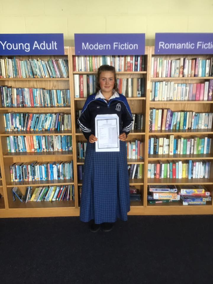 Desmond College student in School Library delighted with their results